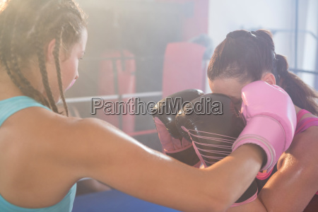 young female boxers fighting in boxing