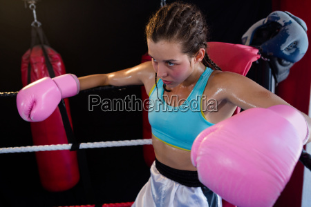 young female boxer sitting in corner