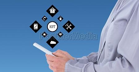 man using digital tablet against cloud