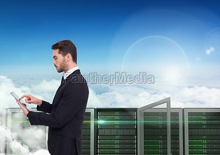 digital composite image of businessman using