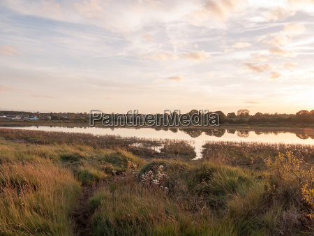amazing sunset lake scene river across