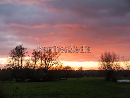 red sun setting sky dramatic autumn