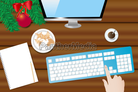 wooden desk with christmas decoration pc