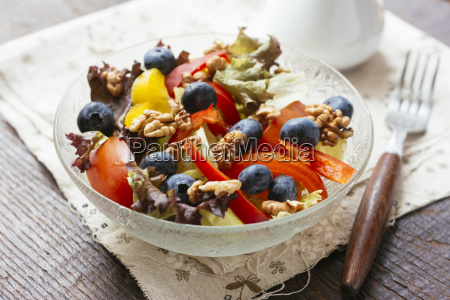 glass bowl of mixed salad with