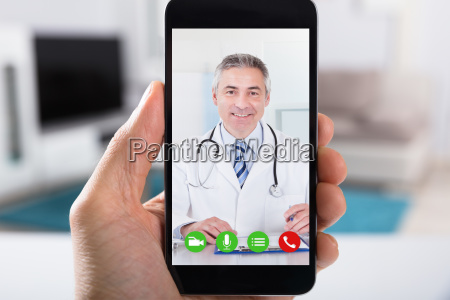 person video conferencing with doctor on