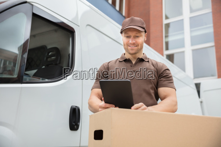 delivery man using digital tablet