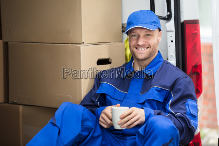 delivery man drinking cup of coffee