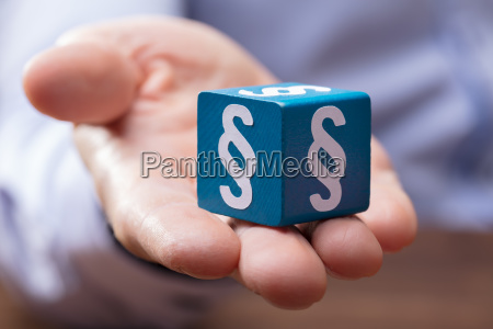 persons hand holding paragraph block