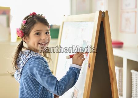 portrait of girl 6 7 writing