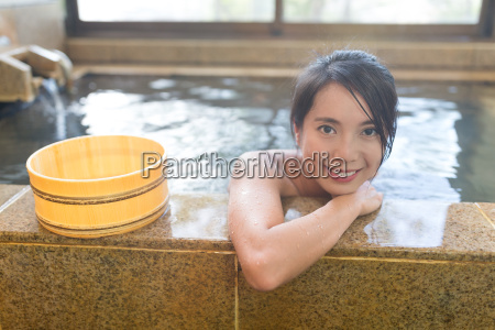 asian woman enjoy japanese hot spring