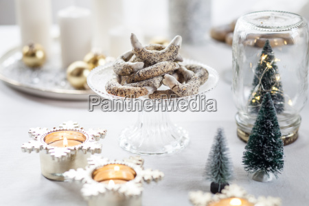 poppy seed cookies on glass cake