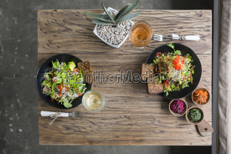 decorated salad bowls on wooden table