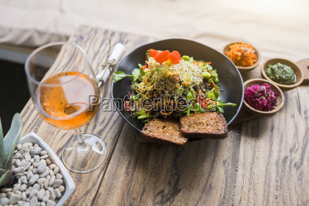 decorated salad bowl on wooden table