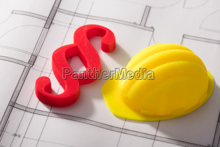 hard hat and paragraph symbol on
