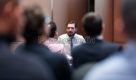 skiled businessman presenting a project to