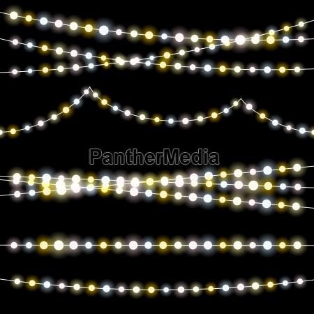 cuerdas ligeras con bombillas ardientes