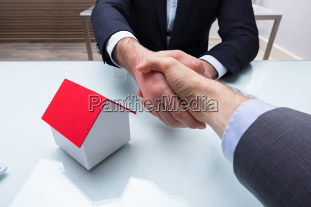 estate agent shaking hand with client