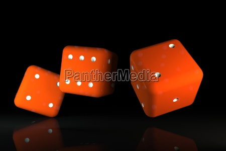 rolling red dice over black background