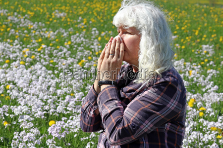 a woman has hay fever in
