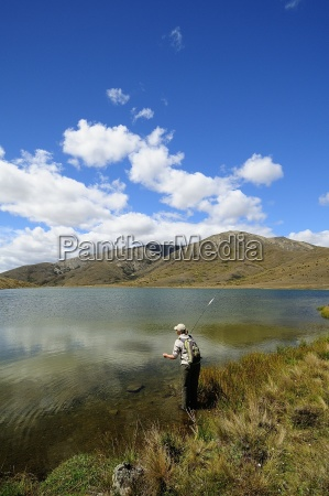 woman fly fishing in lake new