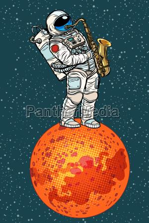 astronauta toca el saxofon en marte