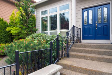 house entry by frontyard garden