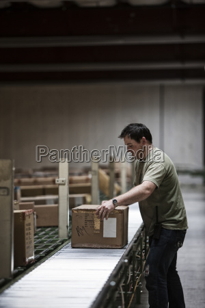 caucasian warehouse worker in a large