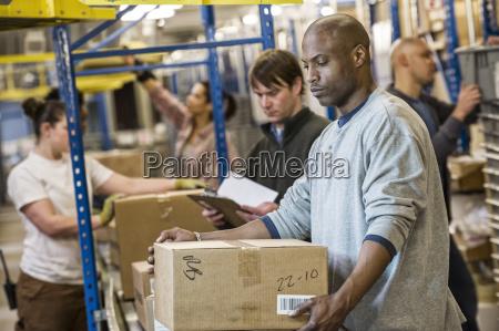 african american warehouse worker and a