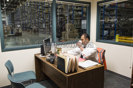 hispanic american executive working on a