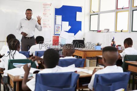 teacher teaching an elementary school class