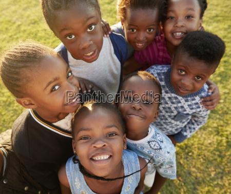 elementary school kids in a field