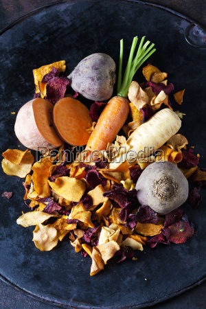 sliced root vegetables and vegetable chips