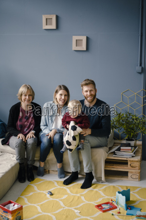 family sitting in living room with