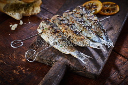 fish on skewers served on rustic