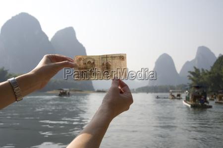 li river yangshuo china person holding