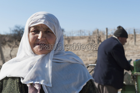 a senior woman wearing a headscarf