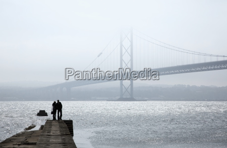 silhouette of a couple standing at