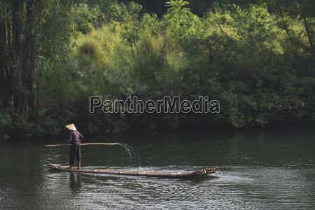 a man paddles in the yulong