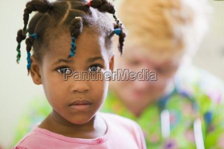 a girl with a volunteer nurse