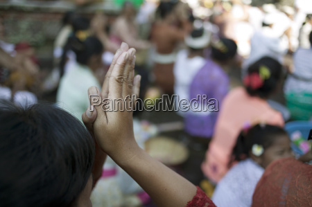 close up of hands in prayer