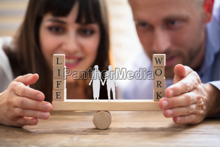 couple protecting balance between work and