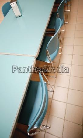 estudio azul educacion interior cafeteria perpendicular