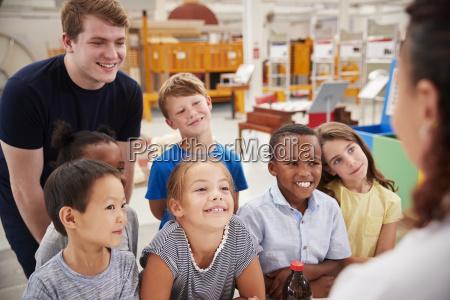 teacher and kids having fun at