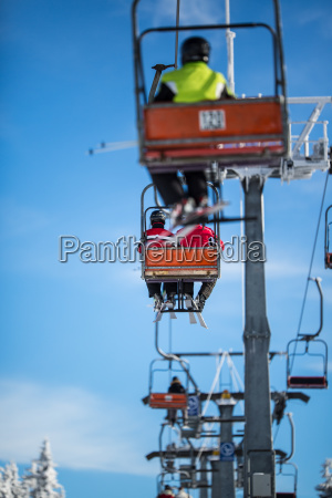 ski lift with skiers being carried