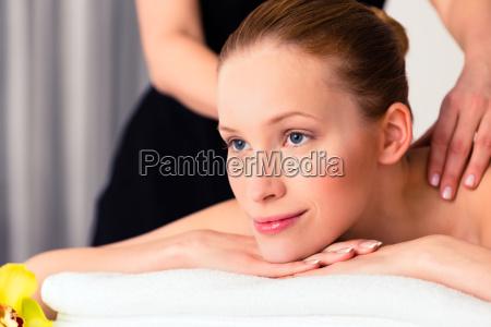 woman having wellness massage in spa