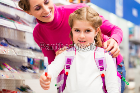 family buying school supplies in stationery