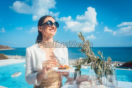woman enjoying some good food on