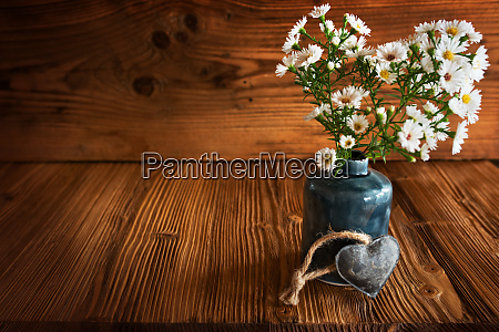 flower decoration on rustic wood