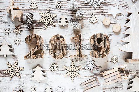 white rustic christmas decoration with text