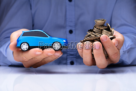 man holding blue car and golden